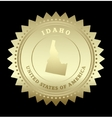 Gold star label Idaho vector image
