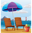 A beach with an umbrella and chairs vector image vector image