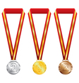 Three medals with gold silver and bronze on red vector image
