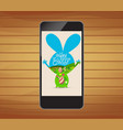 happy easter invitation with floral on smartphone vector image