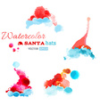 Watercolor Santa hats isolated on white background vector image