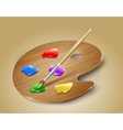Wooden art palette with paints and brush vector image