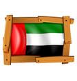 Arab emirates flag in wooden frame vector image