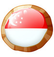 singapore flag on round badge vector image