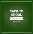 back to school chalked label on green board vector image