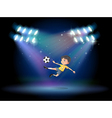 A boy kicking the soccer ball at the stage vector image