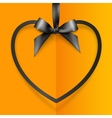 Black heart shape frame hanging on silky ribbon vector image vector image