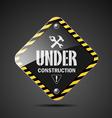 Under construction sign on black background vector image