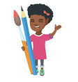 Smiling girl holding big pencil and paintbrush vector image