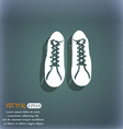 shoes icon On the blue-green abstract background vector image