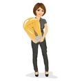 Beautiful businesswoman holding big light bulb vector image