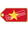 Vintage label with the flag of Vietnam vector image