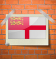Flags Sark scotch taped to a red brick wall vector image