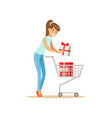 happy woman in a casual clothes putting a gift box vector image
