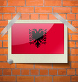Flags Albania scotch taped to a red brick wall vector image