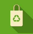 green recycle sign on paper bag icon vector image