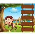 A monkey pointing at the empty signboard vector image