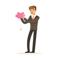 businessman shaking an empty piggy bank vector image