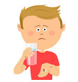 unhappy little boy with glass of water shows pils vector image