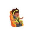 adorable african little girl sitting in orange car vector image