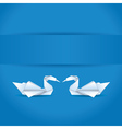 Origami swans on blue background vector image