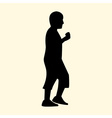 a silhouette of a little boy is walking and eating vector image