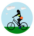 sport beautiful girl rides a bicycle in the vector image