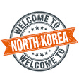 welcome to North Korea orange round ribbon stamp vector image