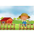 A farmer holding a hoe inside the wooden fence vector image vector image