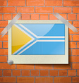 Flags Tuva scotch taped to a red brick wall vector image