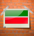 Flags Tatarstan scotch taped to a red brick wall vector image