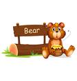 A bear holding a honey beside a wooden signboard vector image