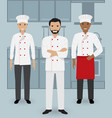 chef and two cook in uniform standing together vector image