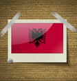 Flags Albania at frame on a brick background vector image