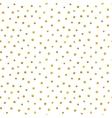 Seamless pattern of random golden dots vector image