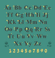 black alphabet with yellow floral decor vector image