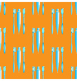 Toothbrush and toothpaste blue on the orange vector image