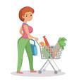 woman pushing supermarket shopping cart full of vector image
