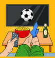 man with remote control watching football on tv vector image