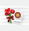 cup of coffee with red tulips and red ribbon vector image