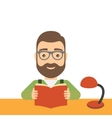 Man reads a book while sitting at the table vector image