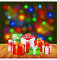 Christmas gifts on wooden table colorful vector image