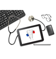 Tablet touch pad and office supplies on the table vector image vector image