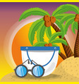 Summer bag and sun glasses over sand with a vector image
