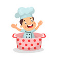 cute cartoon little boy chef character sitting in vector image