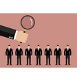 Hand holding magnifying glass to find employee vector image