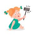 Cute cartoon redhead girl making selfie with a vector image