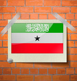 Flags South Africa scotch taped to a red brick vector image