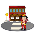 A fireman holding a fire extinguisher vector image vector image