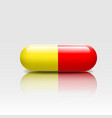 Medical pill red yellow colors vector image